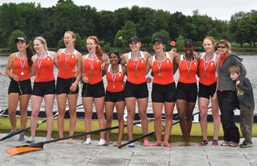 OPEN SEASON: Members of the Princeton University women's open crew varsity 8 celebrate with head coach Lori Dauphiny, second from right, after winning their Grand Final at the Ivy League Championships regatta last Sunday on Cooper River in Camden, N.J. The varsity 8's win earned the Tigers the league's automatic bid to the NCAA championship regatta and helped Princeton win the Ivy team points title, which it took with an 81-74 edge over second-place Radcliffe. Princeton is next in action when it competes in the NCAA Championships in Indianapolis, Ind. from May 31-June 2.(Photo by Craig Sachson, Courtesy of Princeton's Office of Athletic Communications)