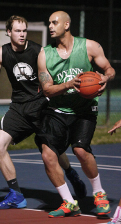 INSIDE JOB: Mark Aziz of Ivy Inn handles the ball down low in recent action in the Princeton Recreation Department Summer Men's Basketball League. Aziz's powerful inside game at both ends of the court has helped Ivy Inn get off to a 4-0 start this season. Ivy Inn and SAT Smart/Princeton Soup and Sandwich (3-0) are the only teams remaining undefeated so far this summer. (Photo by Frank Wojciechowski)