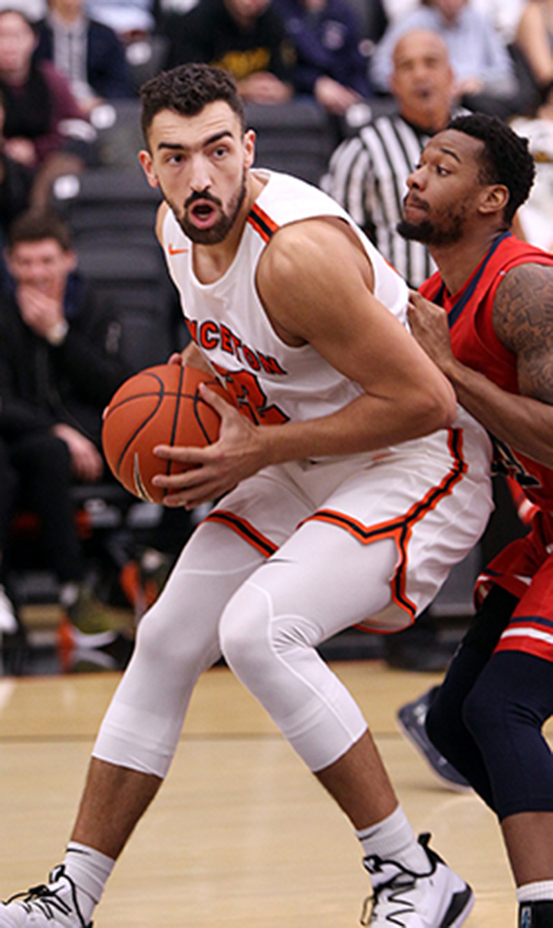 a691b68908e ROSY OUTLOOK: Princeton University men's basketball player Jerome  Desrosiers posts up a foe in recent action. Sophomore forward Desrosiers  has been a spark ...